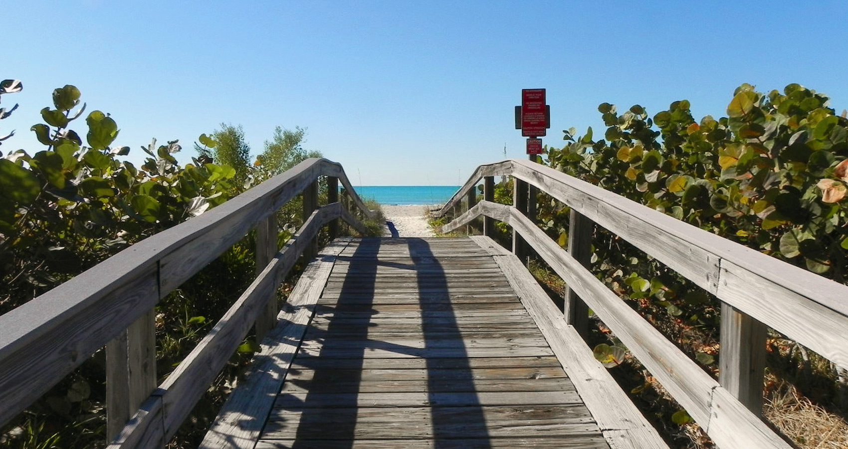A wooden footbridge leading to the beach